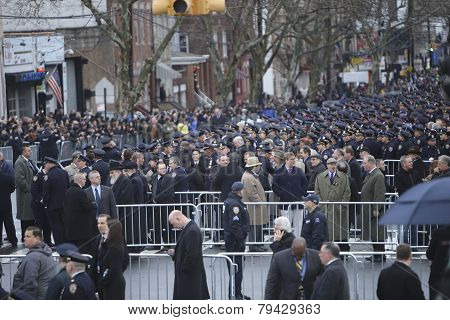 NYPD officers in formation along 65th St