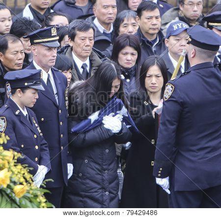 Pei Xia Chen receives folded flag