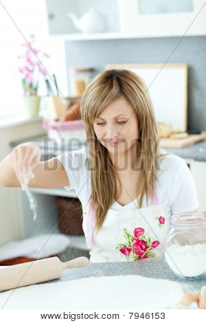 Smiling Woman Preparing Cakes In The Kitchen