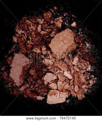 Close up of a make up powder on black background