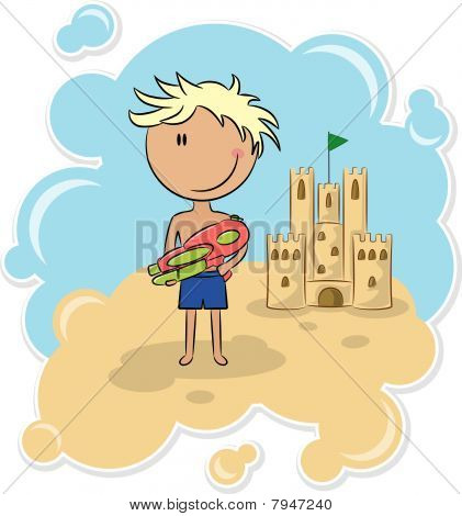 Cheerful boy and the sand castle