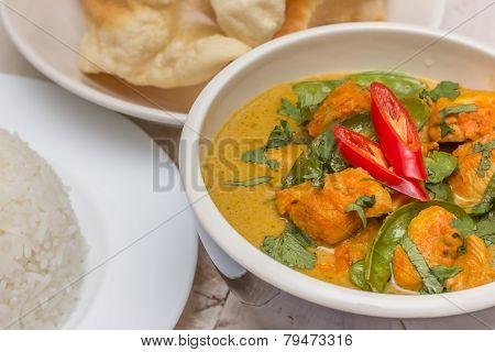 Indian green curry with chicken basmati rice and papadums poster