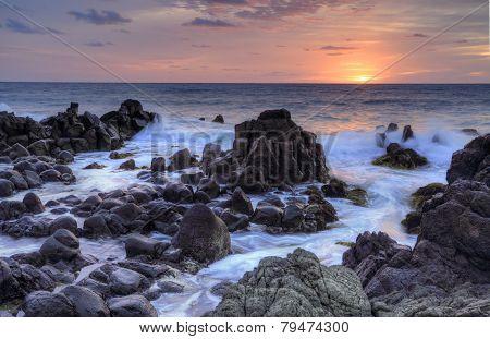 Sunrise And Minamurra Volcanic Rocks At Low Tide
