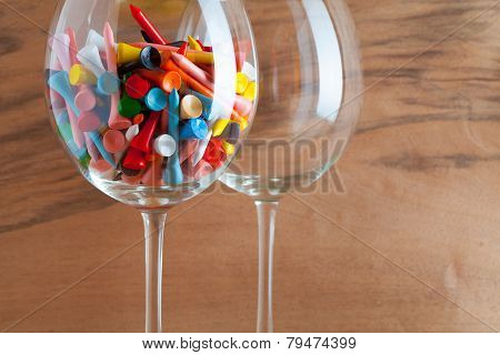 Two Glasses Of Wine And Golf Tees
