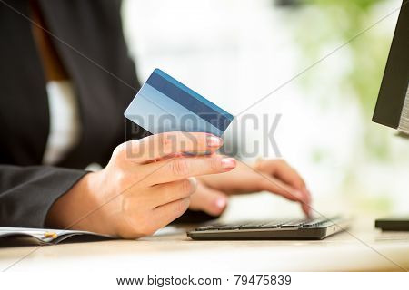 Business woman hands with credit card