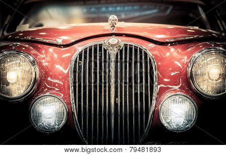 Front Headlights And Grille Of A Vintage Jaguar.