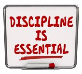 Discipline is Essential words on a dry erase board to communicate the importance of being committed to a job or task and exercising restraint and control to achieve the goal poster