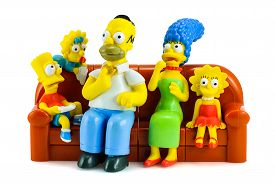 Simpsons Family On Sofa And See The Scary Movie Figure Toy Character From The Simpsons Family.