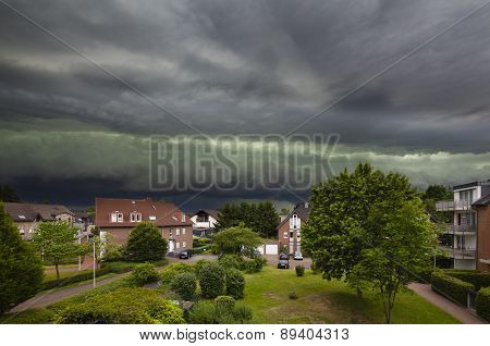 Approaching Thunderstorm Over Residential District