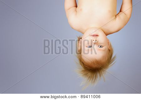 Little cute baby upside down. Childhood. Healthcare.