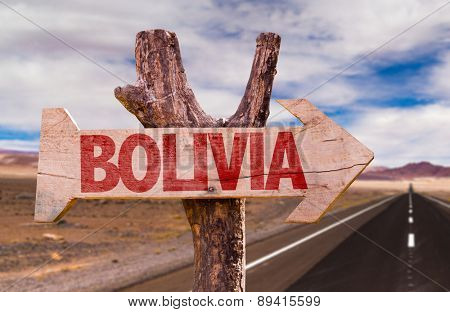 Bolivia wooden sign with Valle de la Luna background