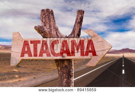 Atacama wooden sign with Valle de la Luna background