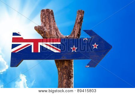 New Zealand Flag wooden sign with sky background