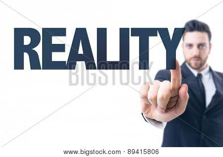 Business man pointing the text: Reality