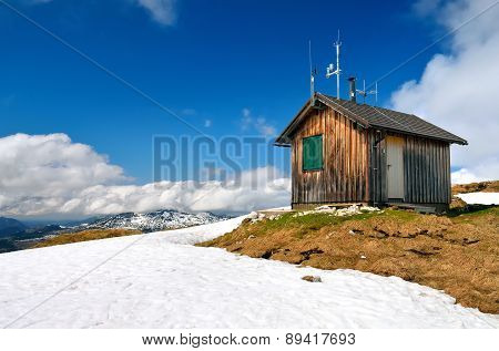 Wooden hut in mountains.