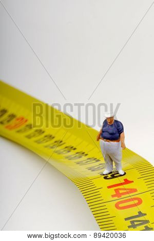 fat man and measurer - obesity concept