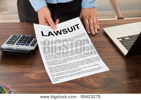 Lawyer Showing The Lawsuit Document