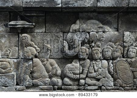 Ascetic men and elephants. Stone bas relief from the Borobudur Temle in Central Java, Indonesia.