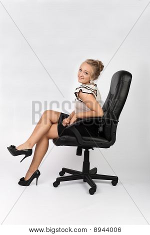 Girl Sitting On An Office Chair