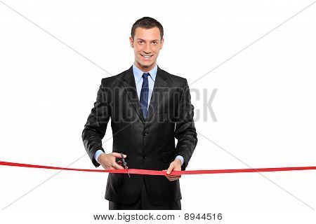 A Man Cutting A Red Ribbon, Opening Ceremony