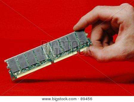 Hand Holding A Dimm Memory Card