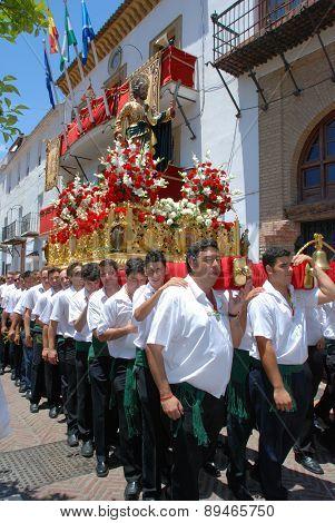 Bearers carrying Saint Bernard Float.