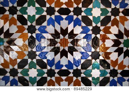 Ben Youssef Madrasa, Marrakech, Morocco - April 15, 2015: tiles on the wall