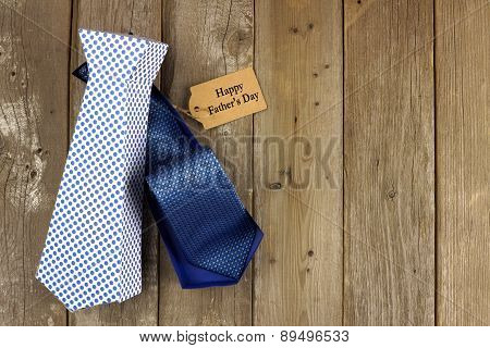 Opened Fathers Day tie shaped gift box on wood background
