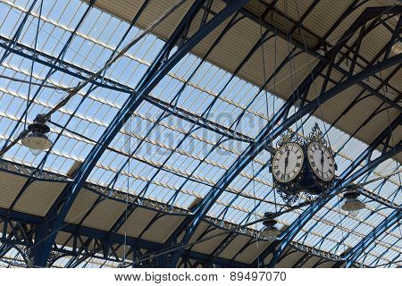 April 2015 - Brighton, England: Train station At Brighton Looking Up The Roof And Clock
