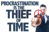 Business man pointing the text: Procrastination Is The Thief of Time poster