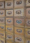 Drawers with blank tags in vintage furniture module poster