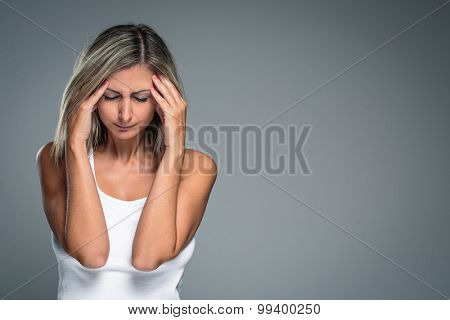 Gorgeous young woman with severe headache/migraine/depression symptoms (color toned image)