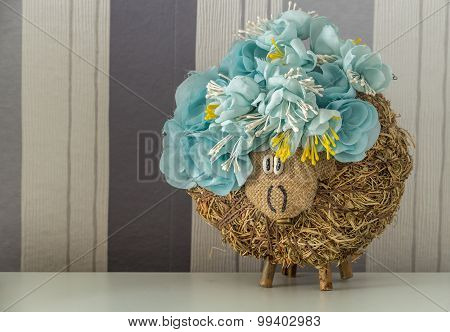 Handmade hey sheep with blue flowers