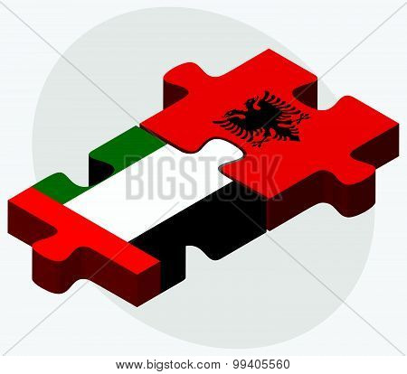 United Arab Emirates and Albania Flags in puzzle isolated on white background. poster