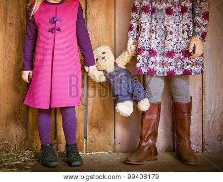 Two Little Sisters With Toy Bear