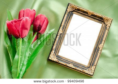 Blank Picture Frames And Red Tulips Flowers.