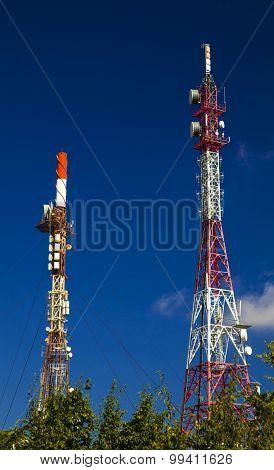 Radio communication antenna tower on blue sky poster