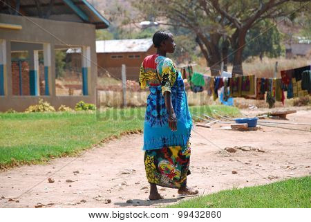 A Pregnant African Woman Walks In The Courtyard Of The Ipamba Hospital In Iringa In Tanzania - 238