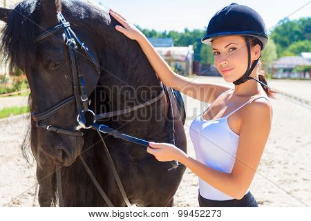 Beautiful horsewoman with a horse