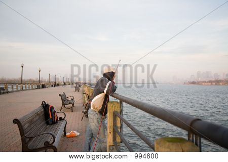 Lonely Man Fishing In Sunset