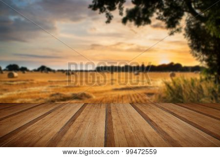 Rural Landscape Image Of Summer Sunset Over Field Of Hay Bales With Wooden Planks Floor