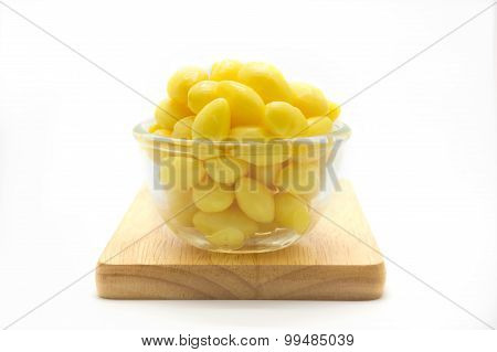 Cup of boiled Ginkgo nut on wooden board