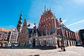 Riga Latvia- August 20 2015: Day view of the Town Hall Square and the Blackheads House. The building of the Brotherhood of Blackheads is one of the most iconic buildings of Old Riga. This is almost certainly the most famous building in Riga and one which poster