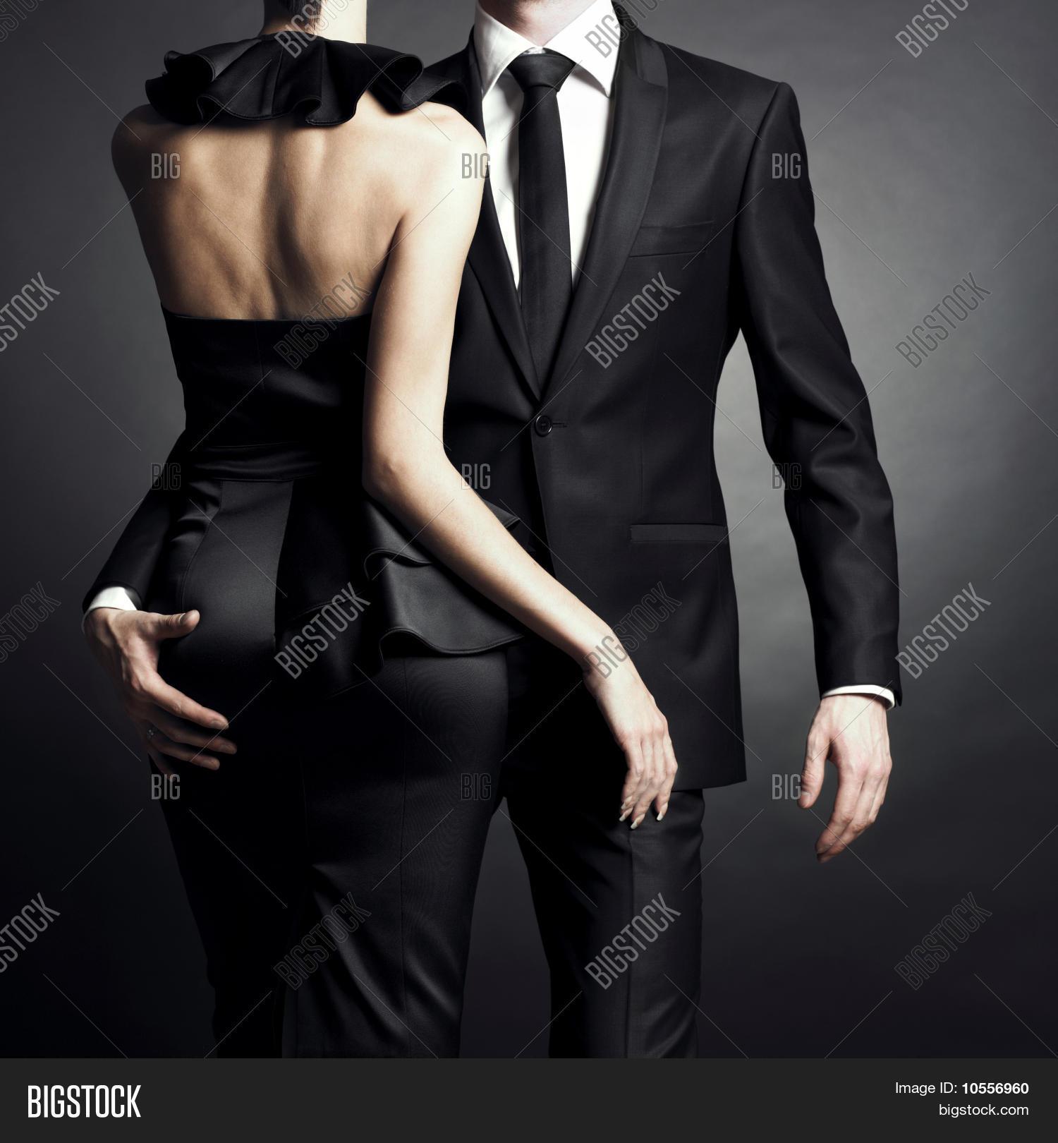 3771b2e1c977f Conceptual portrait of a young couple in elegant evening dresses