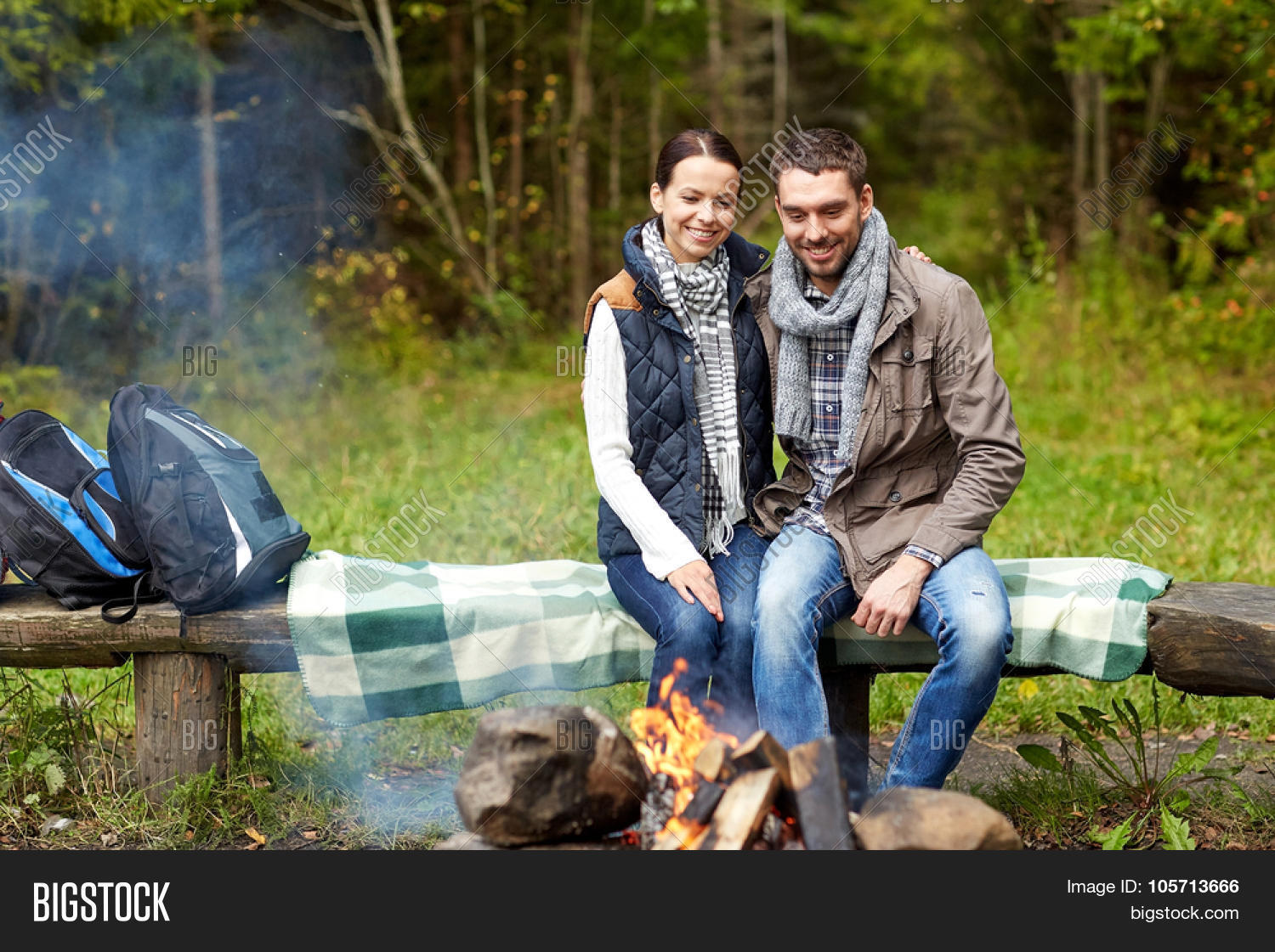 camping travel tourism hike and people concept happy couple sitting on bench camping in the woods m90 camping