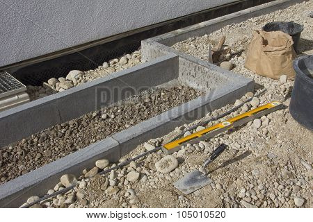 Construction Of Walkway And Flowrebed Bordering