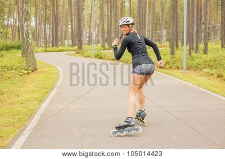 Woman rollerskating and looking back