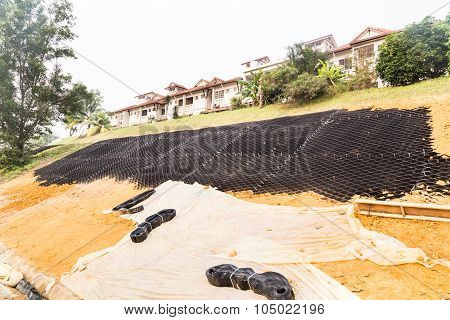 Slope Erosion Control With Grids And Earth On Steep Slope