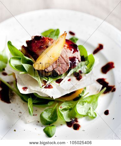 Duck breast roasted with  pear,  salad