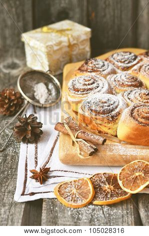 Baking on the wooden table with cinnamon stick toned photo